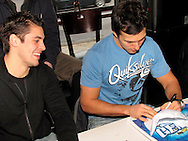 The Dayton Gems Jonathan Ornelas (left) and Corey Couturier sign autographs at Brixx Ice Company, Tuesday, January 19, 2010.