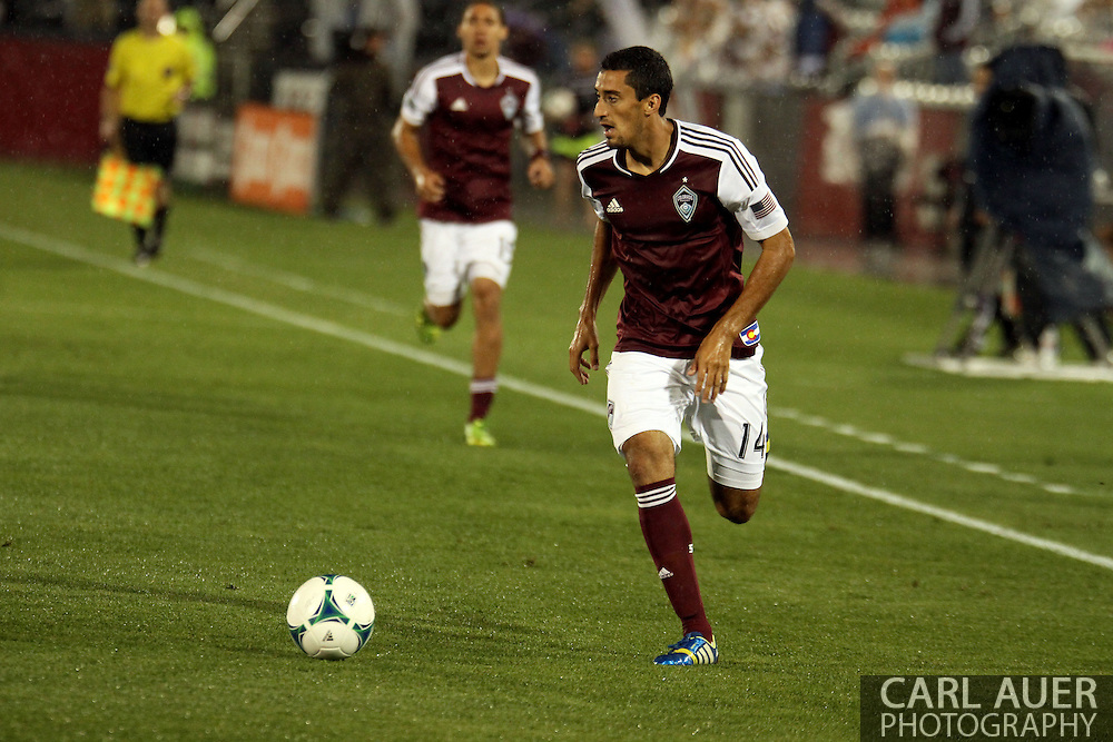 August 3rd, 2013 - Colorado Rapids midfielder Tony Cascio (14) pushes the ball up the field in the second half of action in the Major League Soccer match between Real Salt Lake and the Colorado Rapids at Dick's Sporting Goods Park in Commerce City, CO