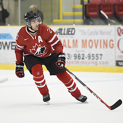 WELLINGTON, - Dec 11, 2015 -  Exhibition Game 2- Team USA vs Team Canada East at the 2015 World Junior A Challenge at the Wellington District Community Centre, ON. Maxime St. Pierre #25 of Team Canada East follows the play during the second period.<br /> (Photo: Andy Corneau / OJHL Images)