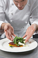 Male chef preparing salad in kitchen