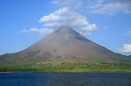 Arenal Volcano. Lake Arenal in foreground. Costa Rica.<br />