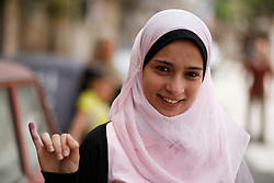 """I thank God for the opportunity [to elect our president]. I thought the day would never come. I'm optimistic. I voted for Aboul Fotouh but I'll be happy with the majority. We all need to work to make Egypt better."" - Riham Mustafa, 20"