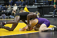 December 8, 2011: Iowa Hawkeyes Montell Marion works on Northern Iowa Panthers Seth Noble in the 141 pound bout of the NCAA wrestling dual between the Northern Iowa Panthers and the Iowa Hawkeyes at Carver-Hawkeye Arena in Iowa CIty, Iowa on Thursday, December 8, 2011. Marion defeated Noble 18-8 and Iowa defeated Northern Iowa 38-4.