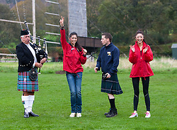 Chen Liu, Miss China and Chu Hay Man Hyman, Miss Hong Kong pose with Ross McMillan  and Pipe Major David Boyle during the caber tossing at the Miss World Highland Games..The Miss World 2011 contestants take part in a highland games in the grounds of Crieff Hydro, Perthshire..MISS WORLD 2011 VISITS SCOTLAND..Pic © Michael Schofield.