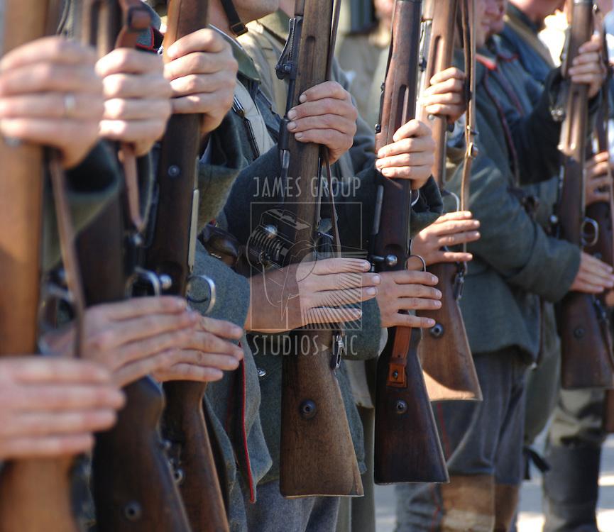 German World War II soldiers presenting arms