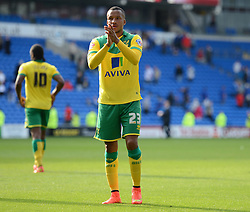Norwich's Martin Olsson claps the away supporters. - Photo mandatory by-line: Alex James/JMP - Mobile: 07966 386802 30/08/2014 - SPORT - FOOTBALL - Cardiff - Cardiff City stadium - Cardiff City  v Norwich City - Barclays Premier League