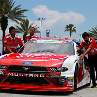 The car of Ryan Reed (16) is pushed in the garage before practice for the Coca-Cola Firecracker 250 at Daytona International Speedway in Daytona Beach, Florida.