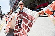 """Jul 20, 2016; Cleveland, OH, USA; Protestors form a """"Wall of Trump"""" in downtown Cleveland at the site of the Republican National Convention."""