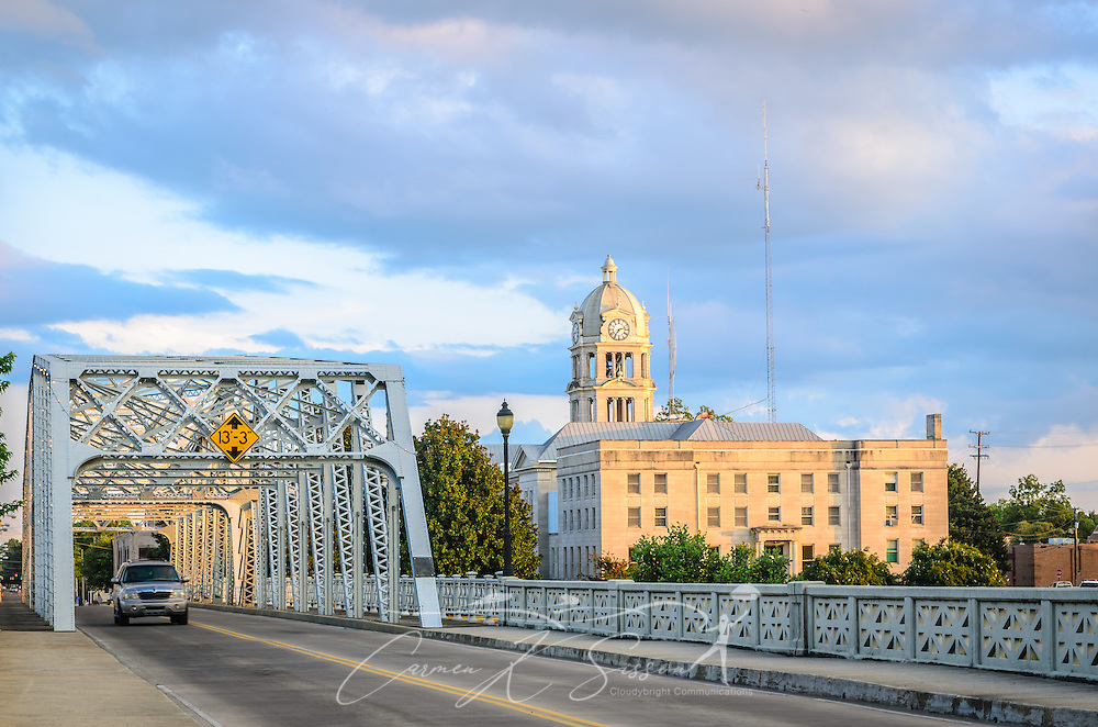 A car drives across Keesler Bridge, which spans the Yazoo River in Greenwood, Miss. In the background is the  Leflore County Courthouse. (Photo by Carmen K. Sisson)
