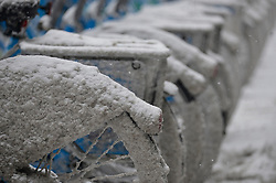 Philadelphia, PA, USA - February 20, 2019: <br /> Bike share, Indego bicycle received a coating from snow removal activities as commuters get an early jump on rush hour as winter storm Petra brings several inches of snow to the Philadelphia region, on February 20, 2019. To accommodate, SEPTA implemented its Early Exit Schedule, running nine Regional Rail trains hours ahead of their normal schedules.