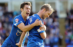 Peterborough United's Grant McCann celebrates scoring with team-mate Tommy Rowe - Photo mandatory by-line: Joe Dent/JMP - Tel: Mobile: 07966 386802 05/10/2013 - SPORT - FOOTBALL - London Road Stadium - Peterborough - Peterborough United V Preston North End - Sky Bet League 1