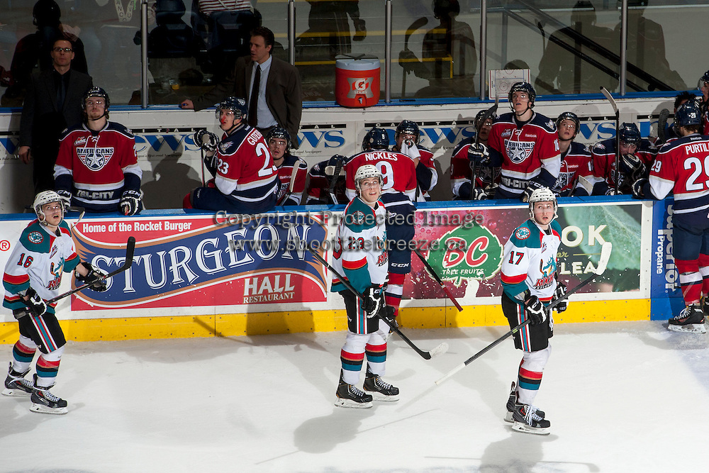 KELOWNA, CANADA - MARCH 8: The Kelowna Rockets watch the goal replay as they skate past the Tri-City Americans bench on March 8, 2014 at Prospera Place in Kelowna, British Columbia, Canada.   (Photo by Marissa Baecker/Getty Images)  *** Local Caption ***