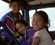 Mongolia, Gobi desert. July 1996: Munkhtsetseg's sisters and friends pose in the cab of the truck.