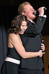 "Christina Oanes embraces MSU Idol winner Chris West as he sings an encore to ""Save the Last Dance For Me"" at the MSU ballroom."