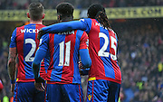 Emmanuel Adebayor and Wilfried Zaha celebrate their equaliser during the Barclays Premier League match between Crystal Palace and Watford at Selhurst Park, London, England on 13 February 2016. Photo by Michael Hulf.