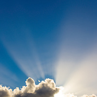 Beautiful sun rays behind the clouds / cl044