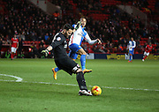 Charlton Athletic goalkeeper, Stephen Henderson (1) clearing from Blackburn Rovers striker, Simeon Jackson (35) during the Sky Bet Championship match between Charlton Athletic and Blackburn Rovers at The Valley, London, England on 23 January 2016. Photo by Matthew Redman.