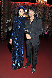 RONNIE WOOD and ANA ARUAJO at a party hosted by Roberto Cavalli to celebrate his new Boutique's opening at 22 Sloane Street, London followed by a party at Battersea Power Station, London SW8 on 17th September 2011.