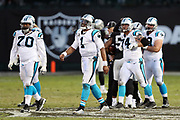 The Oakland Raiders begin to celebrate in the background while Carolina Panthers quarterback Cam Newton (1) grimaces and walks off the field in disappointment after a strip sack and fumble recovery by Oakland Raiders defensive end Khalil Mack (52) that effectively ends the 2016 NFL week 12 regular season football game against the Carolina Panthers on Sunday, Nov. 27, 2016 in Oakland, Calif. The Raiders won the game 35-32. (©Paul Anthony Spinelli)
