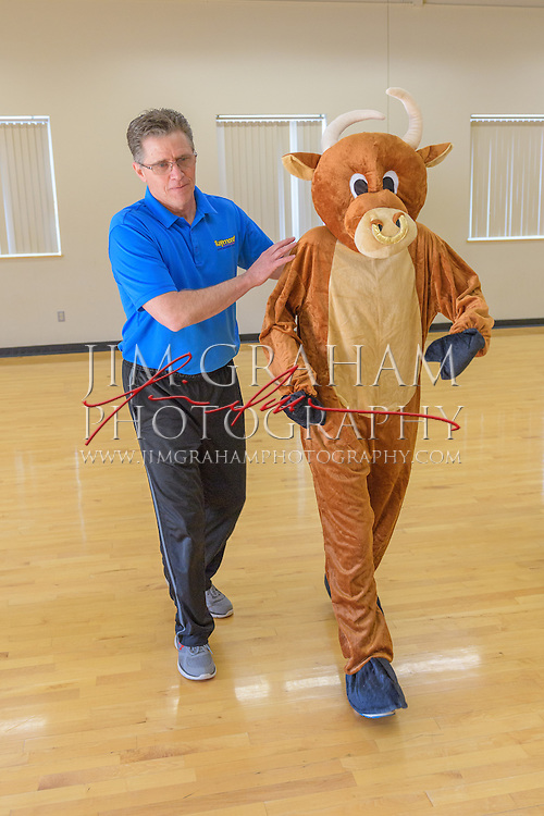"David Raymond pioneered the field of sports mascots as the first inhabitor of the world-renowned Phillie Phanatic leads a Mascot Bootcamp in Kutztown, PA, 8 April 2016. Here he is working with ""Da Bull"" aka Washington Post writer Sarah Larimer. Photograph by Jim Graham"