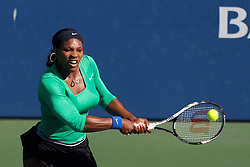 July 28, 2011; Stanford, CA, USA;  Serena Williams (USA) returns the ball against Maria Kirilenko (RUS), not pictured, during the second round of the Bank of the West Classic women's tennis tournament at the Taube Family Tennis Stadium. Williams defeated Kirilenko 6-2, 3-6, 6-2.