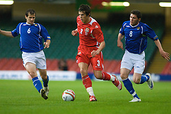 CARDIFF, WALES - Friday, September 5, 2008: Wales' Gareth Bale and Azerbaijan's Elmar Bakhsiyev (L) and Djavid Huseinov (R) during the opening 2010 FIFA World Cup South Africa Qualifying Group 4 match at the Millennium Stadium. (Photo by Gareth Davies/Propaganda)