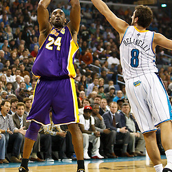 December 29, 2010; New Orleans, LA, USA; Los Angeles Lakers shooting guard Kobe Bryant (24) shoots over New Orleans Hornets shooting guard Marco Belinelli (8) during the first half at the New Orleans Arena.   Mandatory Credit: Derick E. Hingle