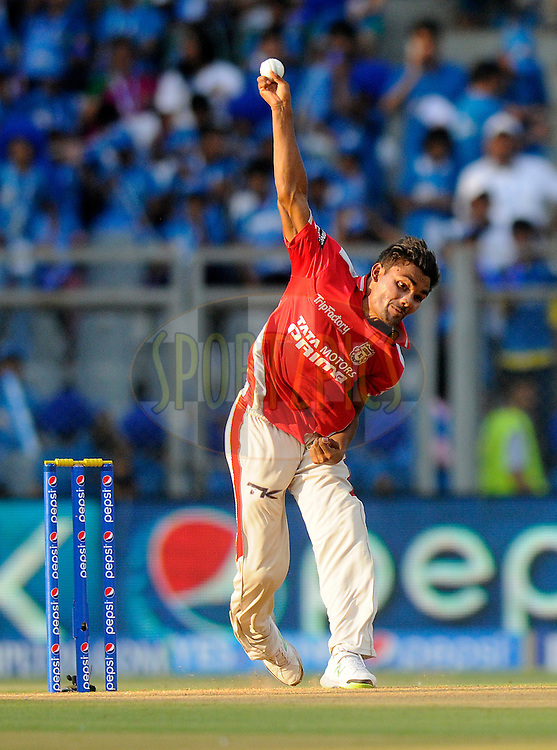 Sandeep Sharma of the Kings X1 Punjab bowls during match 22 of the Pepsi Indian Premier League Season 2014 between the Mumbai Indians and the Kings XI Punjab held at the Wankhede Cricket Stadium, Mumbai, India on the 3rd May  2014<br /> <br /> Photo by Pal Pillai / IPL / SPORTZPICS<br /> <br /> <br /> <br /> Image use subject to terms and conditions which can be found here:  http://sportzpics.photoshelter.com/gallery/Pepsi-IPL-Image-terms-and-conditions/G00004VW1IVJ.gB0/C0000TScjhBM6ikg