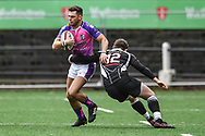 Pontypridd's Lewis Williams is tackled by Bedwas's Mike Callow  - Mandatory by-line: Craig Thomas/Replay images - 30/12/2017 - RUGBY - Sardis Road - Pontypridd, Wales - Pontypridd v Bedwas - Principality Premiership