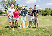 Left to right: Bob Wolfinger, Melissa Arnold, Julie Mann-Keppner, and Saul Phillips at the alumni golf outing. Photo by Lauren Pond