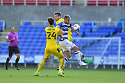 Reading forward George Puscas (47) battles with Barnsley's Aapo Halme (24) during the EFL Sky Bet Championship match between Reading and Barnsley at the Madejski Stadium, Reading, England on 19 September 2020.