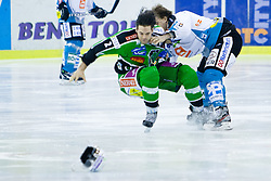 Fight between Brad Cole (HDD Tilia Olimpija, #2) and Brian Lebler (EHC Liwest Linz, #7) during ice-hockey match between HDD Tilia Olimpija and EHC Liwest Black Wings Linz in 51st Round of EBEL league, on Februar 5, 2012 at Hala Tivoli, Ljubljana, Slovenia. (Photo By Matic Klansek Velej / Sportida)