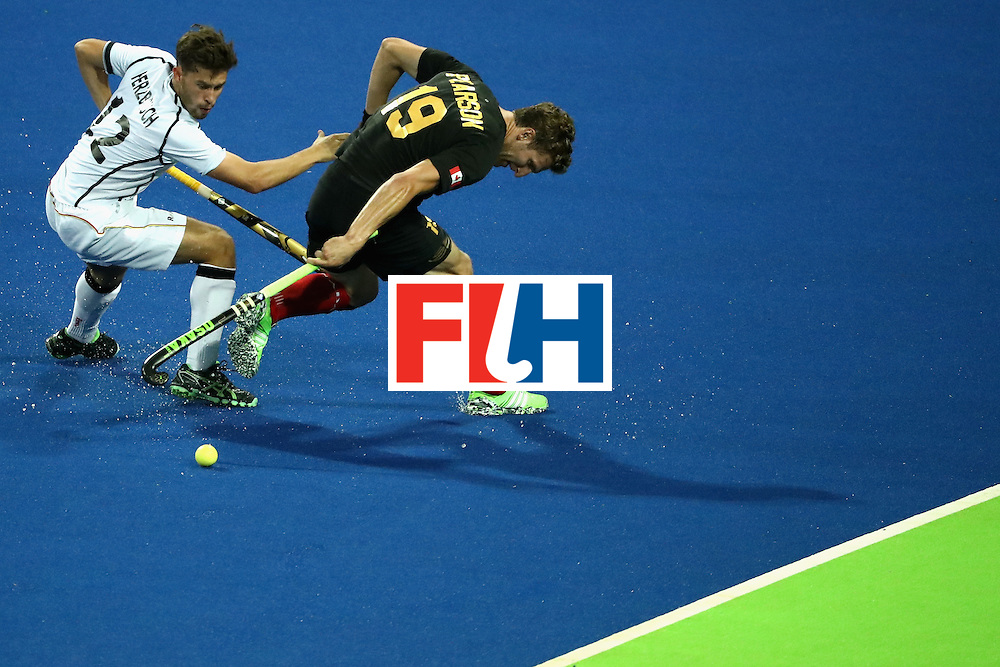 RIO DE JANEIRO, BRAZIL - AUGUST 06:  Timm Herzbruch #12 of Germany battles Mark Pearson #19 of Canada for a loose ball during a Men's Pool B match between Germany and Canada on Day 1 of the Rio 2016 Olympic Games at the Olympic Hockey Centre on August 6, 2016 in Rio de Janeiro, Brazil.  (Photo by Sean M. Haffey/Getty Images)