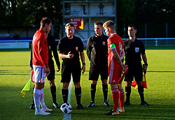 BANGOR, WALES - Monday, October 15, 2018: Referee Tom Williams tosses the coin as Wales' captain Ryan Reynolds and Poland's captain Jake Kiwior look on before the UEFA Under-19 International Friendly match between Wales and Poland at the VSM Bangor Stadium. (Pic by Paul Greenwood/Propaganda)