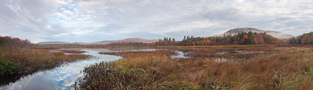 Adirondacks, NY.<br /> A few miles south of Speculator, NY, the Sacandaga and Kunjamuk Rivers meet in Kunjamuk Bay.  Somewhat of a haze had settled over the landscape, and the atmosphere above couldn't decide whether to break open or stay overcast.