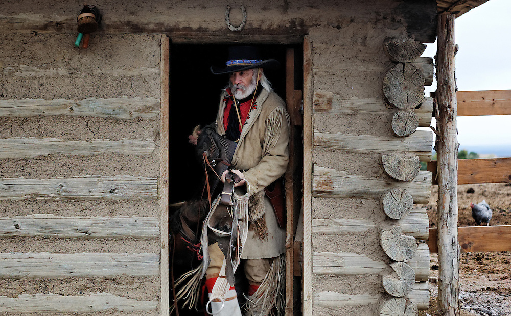 Dan Deuter with his horse Quigley at his home near Montrose, Colorado.<br /> <br /> Photo by Barton Glasser