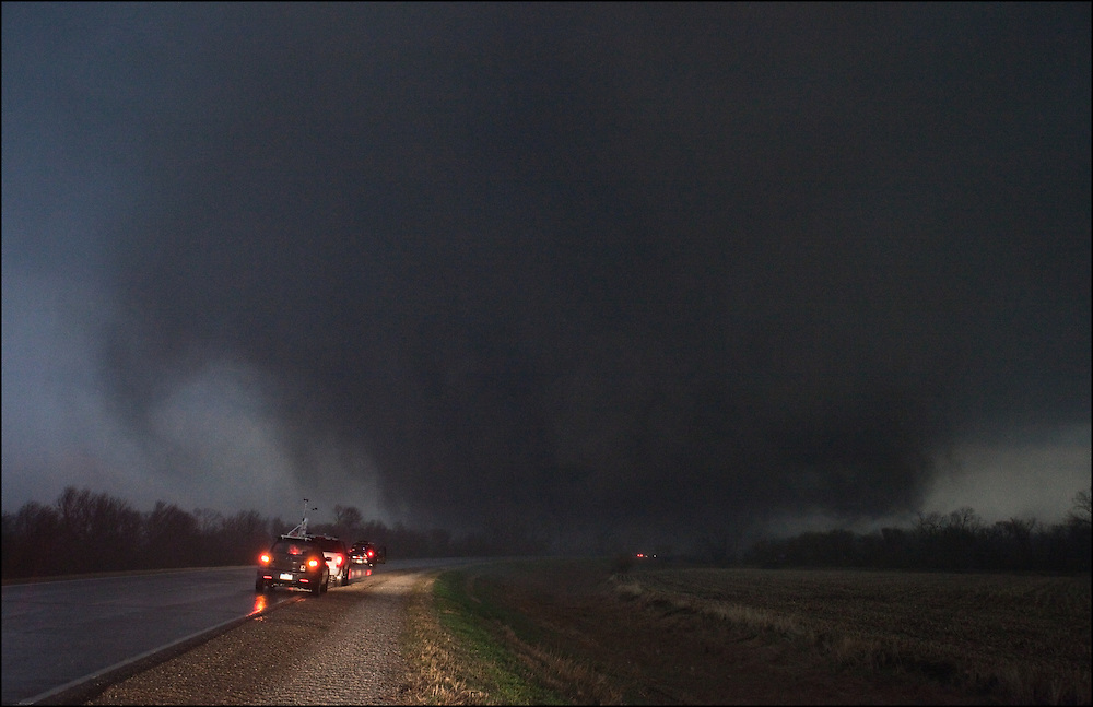 Multiple chasers pull over on the side of the road waiting for an EF-3 tornado as it rips through the town of Mapleton, Iowa.