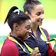 Gymnastics - Olympics: Day 6 Simone Biles #391 of the United States with her gold medal and silver medal medalist Alexandra Raisman #395 of the United States during the Artistic Gymnastics Women's Individual All-Around Final at the Rio Olympic Arena on August 11, 2016 in Rio de Janeiro, Brazil. (Photo by Tim Clayton/Corbis via Getty Images)