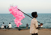 India, pondicherry, People at leisure, on the beach vendor sells pink candyfloss
