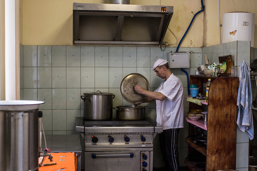 YEKATERINBURG, RUSSIA - OCTOBER 16: Andrei, a former drug addict who cooks for the rest of the patients in treatment for drug addiction at City Without Drugs, prepares soup on October 16, 2013 in Yekaterinburg, Russia. City Without Drugs is a well-known narcotics treatment program in Russia founded by Yevgeny Roizman, who was elected mayor of Yekaterinburg in September 2013. (Photo by Brendan Hoffman/Getty Images) *** Local Caption ***
