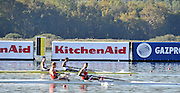 Varese,  ITALY. 2012 FISA European Championships, Lake Varese Regatta Course. ..Men's Pair, Repechage. GBR M2- Bow. Kieran EMERY and Matt TARRANT, watching the second placed pair from Poland [POL M2-] as  both crews  go through to Sundays Final...09:51:16  Saturday  15/09/2012 .....[Mandatory Credit Peter Spurrier:  Intersport Images]  ..2012 European Rowing Championships Rowing, European,  2012 010829.jpg.....