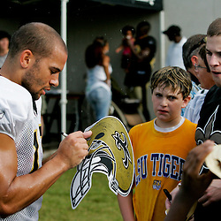 04 August 2009: New Orleans Saints wide receiver Lance Moore (16) signs autographs for fans in a downpour following the end of practice during New Orleans Saints training camp at the team's practice facility in Metairie, Louisiana.