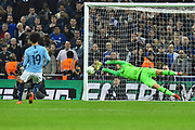 Kepa Arrizabalaga (1) of Chelsea saves Leroy Sane (19) of Manchester City penalty during the shoot out after the match finished 0-0 after extra time during the Carabao Cup Final match between Chelsea and Manchester City at Wembley Stadium, London, England on 24 February 2019.