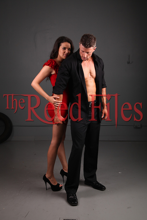Man with beautiful woman in red dress
