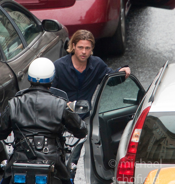 "Day two of filming. Brad Pitt watches the approaching police motorbike on the set of the movie ""World War Z"" being shot in the city centre of Glasgow. The film, which is set in Philadelphia, is being shot in various parts of Glasgow, transforming it to shoot the post apocalyptic zombie film.."