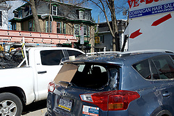 When the tree exploded windows of iMPeRFeCT Gallery and a nearby parked car were damaged as tree particles spread far across the parking lot on the corner of Greene Street.
