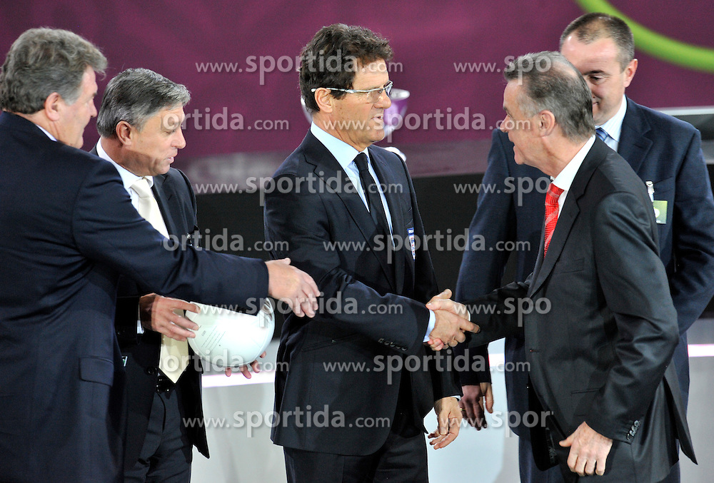 (C) ENGLAND FOOTBALL COACH FABIO CAPELLO SHAKES HANDS WITH (R) OTTMAR HITZFELD COACH OF SWITZERLAND ALONGSIDE (L) JOHN TOSHACK COACH OF WALES AND (2L) ZLATKO KRANJCAR COACH OF MONTENEGRO AFTER THE UEFA EURO 2012 QUALIFYING DRAW IN PALACE SCIENCE AND CULTURE IN WARSAW, POLAND..THE 2012 EUROPEAN SOCCER CHAMPIONSHIP WILL BE HOSTED BY POLAND AND UKRAINE...WARSAW, POLAND , FEBRUARY 07, 2010..( PHOTO BY ADAM NURKIEWICZ / MEDIASPORT / SPORTIDA.COM ).