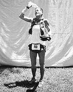 Diana Treister (F) 42 Altadena CA 32:10<br /> Angeles Crest 100 finish liine portraits, July 23-24 2011. Alta Loma Park, Altadena CA