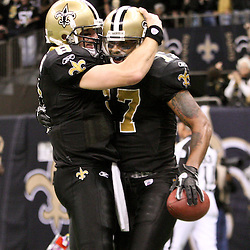 December 26, 2011; New Orleans, LA, USA; New Orleans Saints quarterback Drew Brees (9) celebrates with wide receiver Robert Meachem (17) following a touchdown against the Atlanta Falcons during a game at the Mercedes-Benz Superdome. The Saints defeated the Falcons 45-16.  Mandatory Credit: Derick E. Hingle-US PRESSWIRE