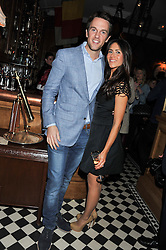 DUNCAN STIRLING and his wife ZOE at a party to celebrate the launch Mr Fogg's, 15 Bruton Lane, London W1 on 21st May 2013.